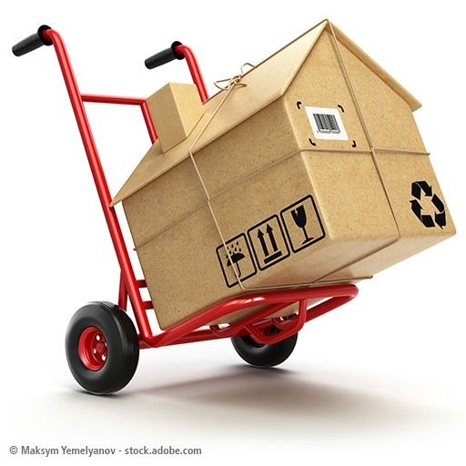 Delivery or moving houseconcept. Hand truck with cardboard box a
